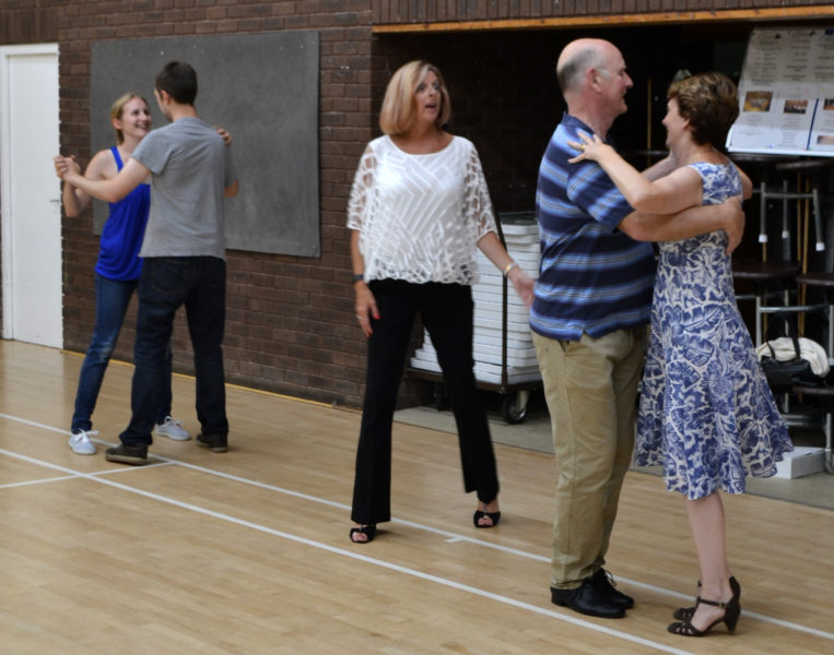 Elaine Proverbs helping pupils at the dance school with their routine